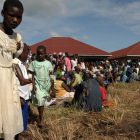 Ugandan patients waiting outside clinic