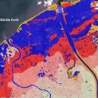 Satellite map of Banda Aceh, showing flooded land (blue) and devastated (red) and affected (pink) urban areas