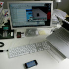 A desktop computer, laptop and smartphone