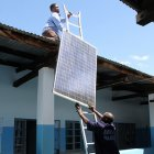 Putting up solar panels in Tanzania