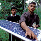 Men with solar panels in Sri Lanka
