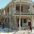Damaged building in Haiti being surveyed