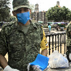 Mexican soldiers hand out face masks