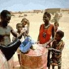 Collecting rationed water in Mali in 1993