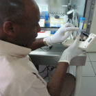Ugandan scientist at JCRC TB lab