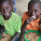 Ugandan boys eating