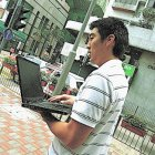 Man using wifi in the street