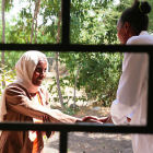 Woman meeting a health worker